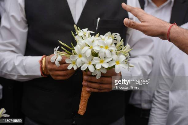 Lawyers distribute flowers among people visiting the District court complex Saket as the entry for the public was opened today on November 7 2019 in...