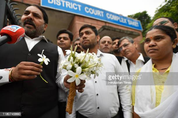 Lawyers distribute flowers among people visiting the Saket District Court Complex as the entry for the public was opened today on November 7 2019 in...