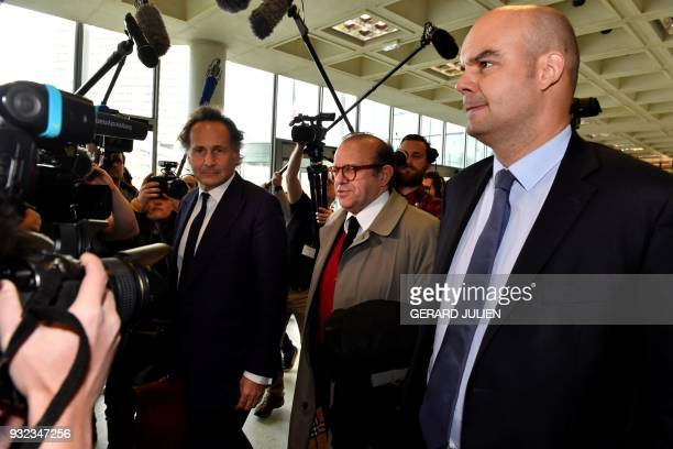 PierreOlivier Sur Herve Temime and Emmanuel Ravanas arrive at a courtroom in Nanterre on March 15 where the two older children of iconic French...