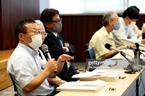 Lawyers for plaintiffs attend a press conference following the ruling by the Hiroshima District Court on July 29, 2020 in Hiroshima, Japan. A local...