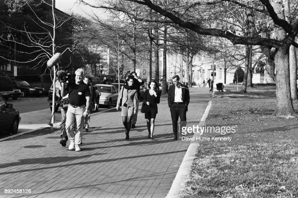 Lawyers for President Bill Clinton including Cheryl Mills Nicole Seligman and Bruce Lindsey walk through Lafayette Square on their way to the White...