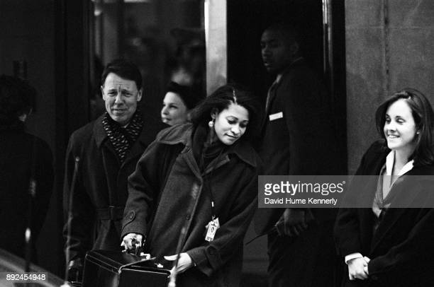 Lawyers for President Bill Clinton including David Kendall Nicole Seligman and Cheryl Mills leave the US Capitol Building during the Senate...