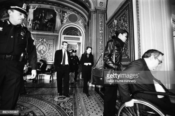 Lawyers for President Bill Clinton including Lanny Breuer Cheryl Mills Nicole Seligman and Charles Ruff leave the Senate Chambers during break from...