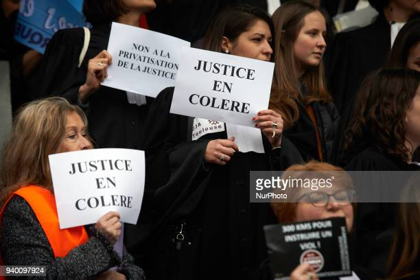 Lawyers hold placards reading 'Angry Justice' The French Bar Association all lawyers' unions all magistrates' unions called all its members to be on...