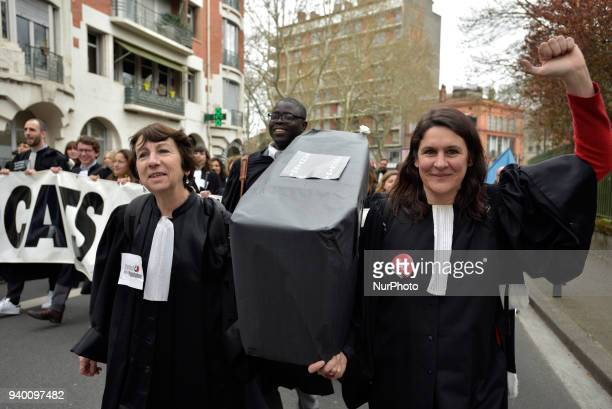 Lawyers holds a false coffin symbolizing the death of Court of First Instance during the protest The French Bar Association all lawyers' unions all...