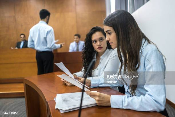 lawyers in trial at the courthouse - trial stock photos and pictures