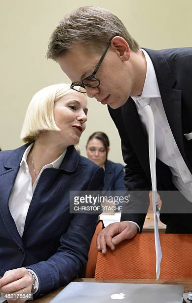 Lawyers of a member of the alleged killer trio called the National Socialist Underground Wolfgang Heer and Anja Sturm talk in the courtroom ahead of...