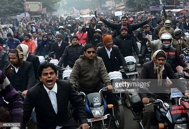 Lawyers of Allahabad High Court participate in a bike rally and shout slogans during a protest against the separation of bench of West Uttar Pradesh...