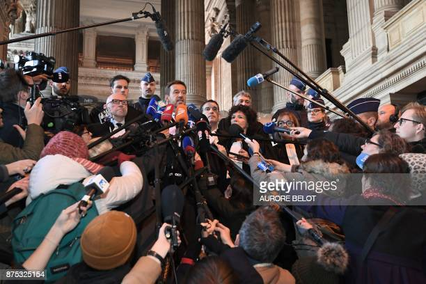Lawyers of axed Catalan separatist leader Carles Puigdemont including Christophe Marchand talks to the press at the Palace of Justice in Brussels on...