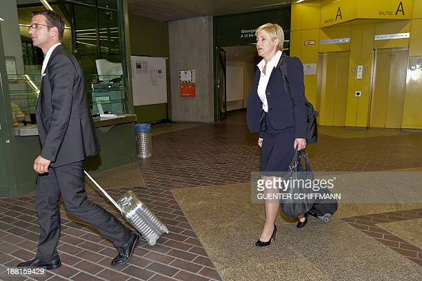 Lawyers of Beate Zschaepe Wolfgang Stahl and Anja Sturm leave the regional courthouse in Munich southern Germany on May 6 2013 after the first day of...