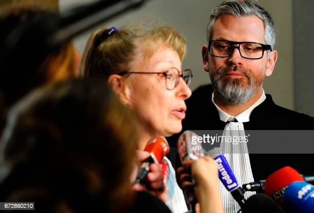 CORRECTION Lawyers of Francis Heaulme Alexandre Bouthier and Liliane Glock speak to journalists during the trial of their client on April 25 2017 in...