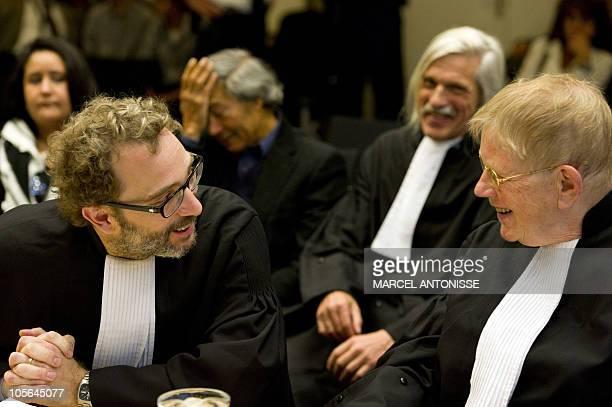 Lawyers of the accusers in the trial of Dutch antiIslam lawmaker Geert Wilders Michiel Pestman and Ties Prakken smile during the trial on October 18...