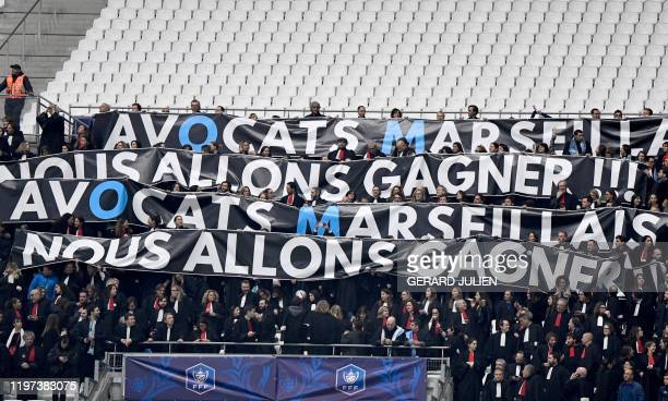 Lawyers of the Marseille's Bar on strike hold a banner reading lawyers from Marseille we are going to win ahead of the French Cup football match...