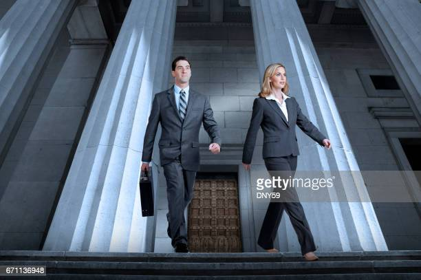 Lawyers Or Business People Leaving Courthouse