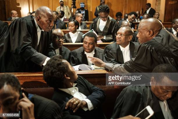 Lawyers react before the hearing seeking to nullify the October 26 repeat presidential election on grounds that the IEBC did not conduct fresh...