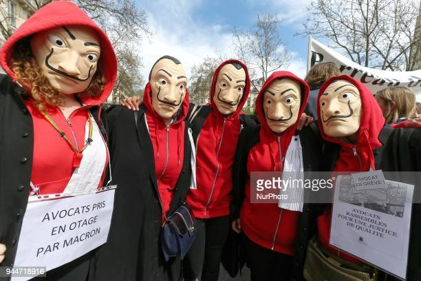 Lawyers registrars and magistrates hold flags signs and banners as they gather in place du Châtelet in Paris on April 11 to protest against a...