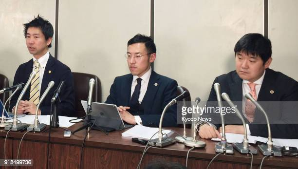 Lawyers representing victims of a massive theft from Japan's virtual currency exchange Coincheck Inc hold a press conference in Tokyo on Feb 15 after...