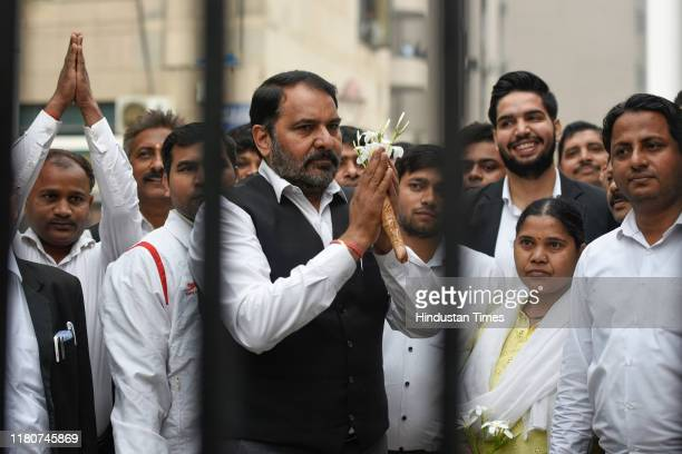 A lawyers seen with flowers as they welcome people visiting the Saket District Court on November 7 2019 in New Delhi India