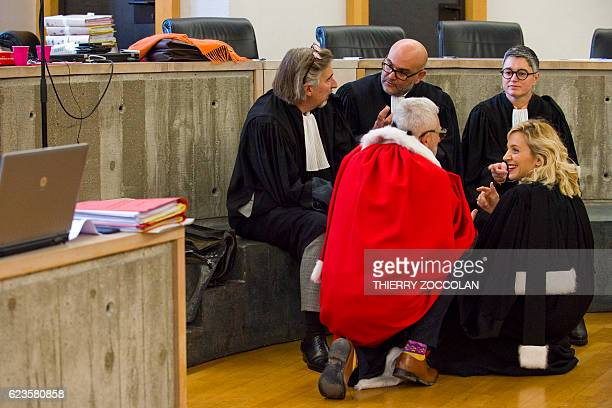 Lawyers speak together on November 16 2016 at the courthouse in Riom near ClermontFerrand central France on November 16 ahead of the trial of Cecile...