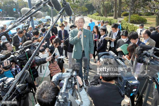 A lawyers speaks after a request for a temporary injunction on the Ikata nuclear plant had been rejected in front of the Hiroshima District Court on...