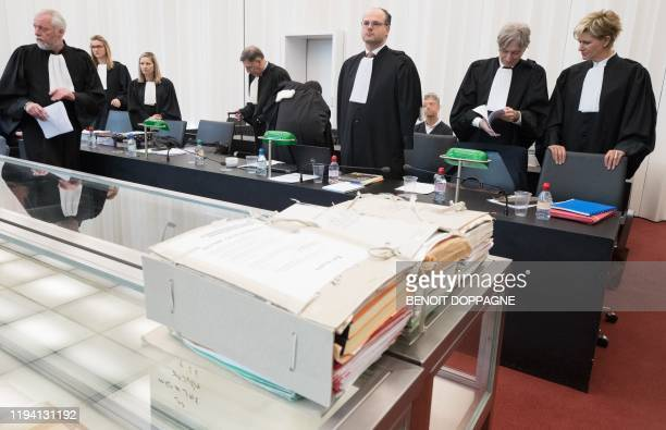 Lawyers stand during the trial of three doctors accused of failing to respect legal conditions in helping to carry out euthanasia in 2010 on a...