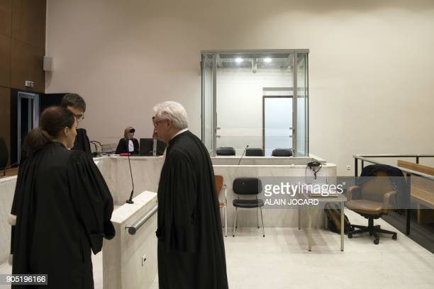 Lawyers stand next to a glass cage in a courtroom on January 15 in Nanterre's courthouse near Paris Lawyers from all over France pleaded on January...