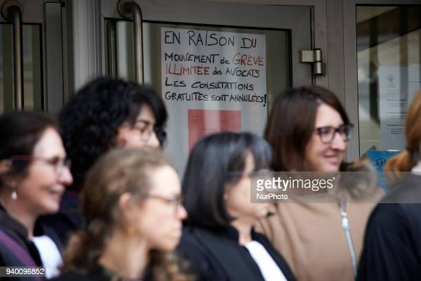 Lawyers staying in front of the entrance of the Court of First Instance of Toulouse where a paper reads 'No consultations due to lawyers's strike'...