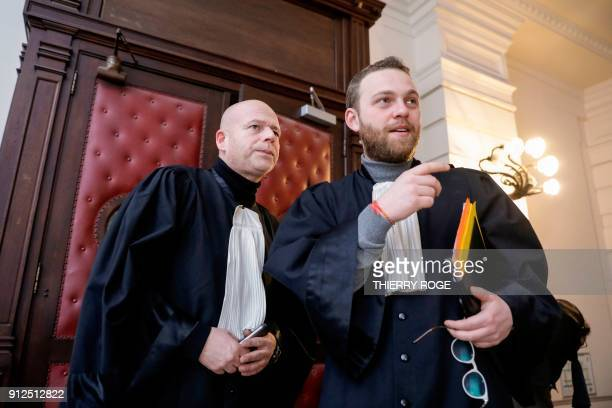 Lawyers Sven Mary and Romain Delcoigne stand in the courthouse during the first session of the 2013 Brussels Airport diamond heist case at the...