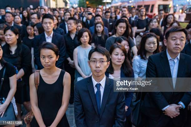 Lawyers take a moment of silence during a protest at the Central Government Complex on June 6 2019 in Hong Kong China Thousands of Hong Kong's legal...