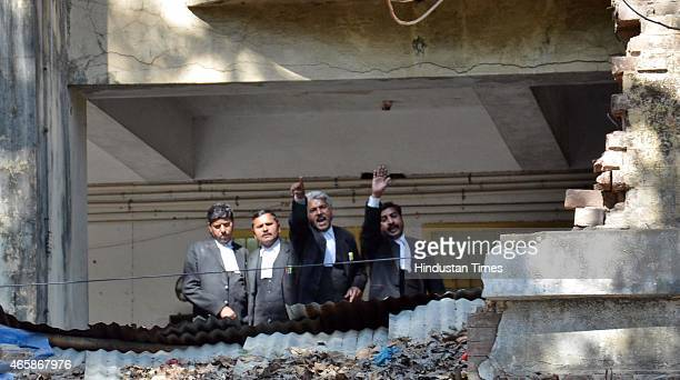 Lawyers watching from a balcony during clash between lawyers and police after a police official shot dead a lawyer and injured another outside the...