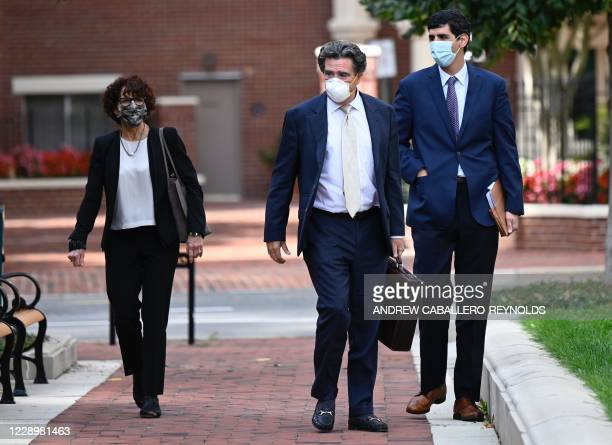 "Lawyers with the defense teams for the two British ISIS militants dubbed ""The Beatles,"" walk back to the Federal Courthouse on October 9, 2020 in..."