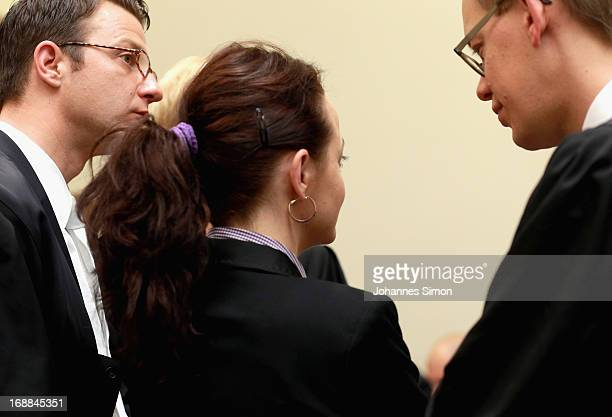 Lawyers Wolfgang Stahl and Wolfgang Heer chat with their client Beate Zschaepe in the courtroom on day four in the courtroom on day four of the NSU...