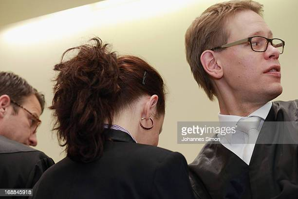 Lawyers Wolfgang Stahl and Wolfgang Heer protect their client Beate Zschaepe against press photographers in the courtroom on day four of the NSU...