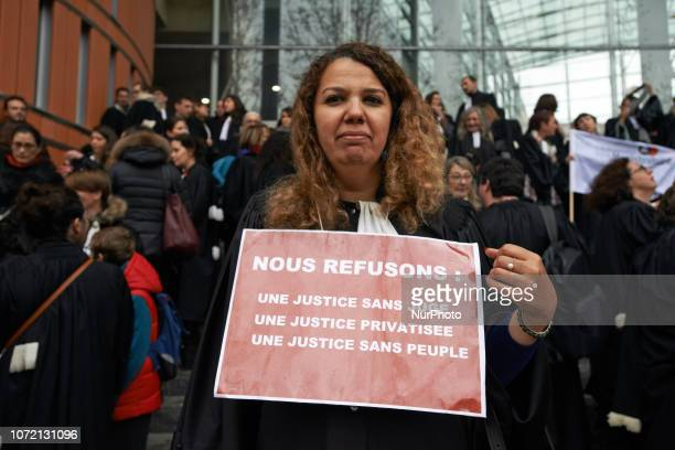 A lawyet has a placard reading 'We refuse a justice withoiut judges a private justice a justice without people' Lawyers counsels and magistrates...