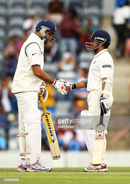 Laxman of India congratulates Sachin Tendulkar after he reached his half century during day two of the International Tour match between India and the...