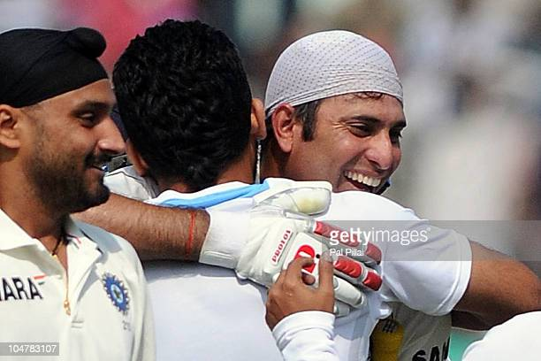 Laxman of India is congrajulated by Zaheer Khan and Harbhajan Singh after their win on day five of the First Test match between India and Australia...