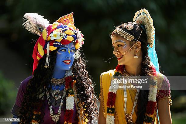 Laxmipriya Patel aged 20 dressed as the Hindu god Lord Krishna and her sister Mohini Patel aged 13 dressed as Lord Krishna's devotee Radharani walk...
