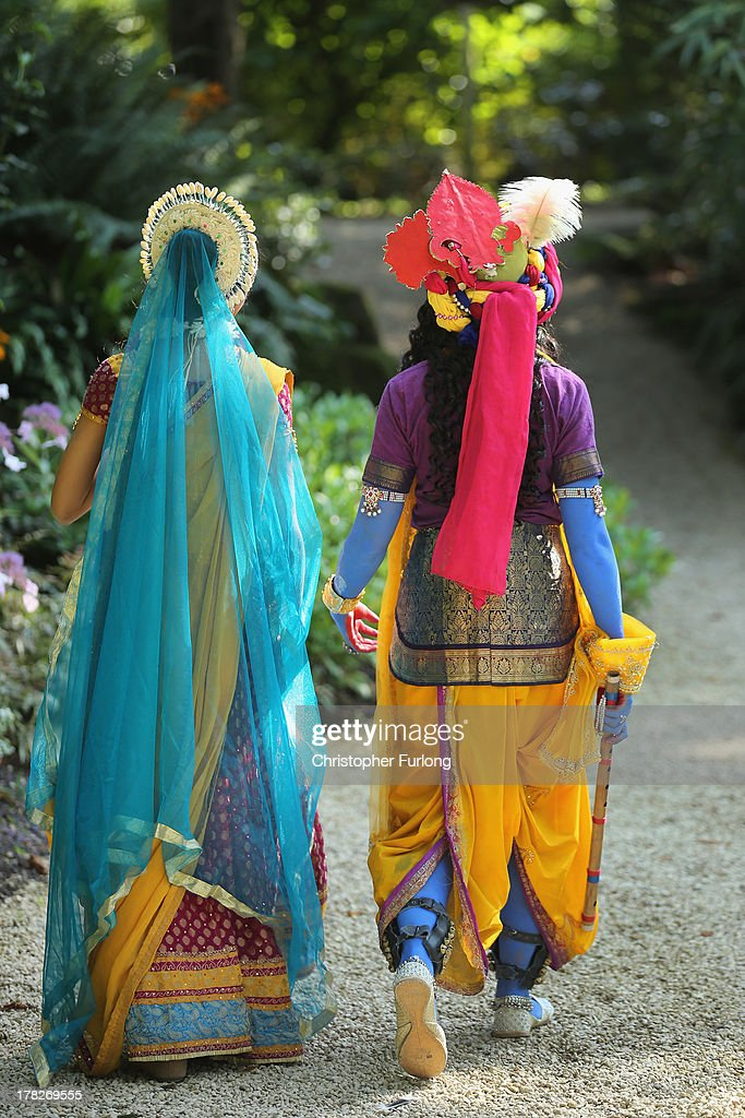 Laxmipriya Patel (R), aged 20, dressed as the Hindu god Lord Krishna, and her sister Mohini Patel, aged 13, dressed as Lord Krishna's devotee Radharani, walk through the George Harrison Memorial Garden during the Janmashtami Hindu Festival at Bhaktivedanta Manor on August 28, 2013 in Watford, England. Up to 72,000 were expected to take part in the Hindu festival of 'Janmashtami', which falls on August 28 this year, and marks the birth of the Hindu god Lord Krishna. The festival is believed to be the largest Hindu festival gathering outside of India. Bhaktivedanta Manor is also celebrating it's 40th year since the manor house was donated to the Society of Krishna Consciousness by George Harrison in 1973.