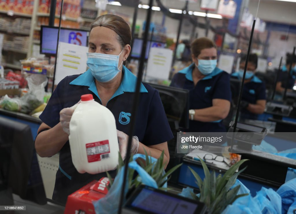 Essential Workers Keep Businesses Open And Serve Customers During COVID-19 Pandemic : News Photo