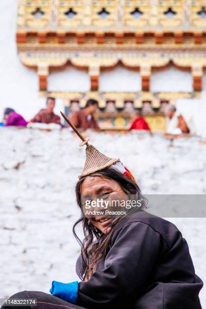 a layap women at the gasa festival. the most distinctive feature of the layap women's dress is their conical hat. - bhutan stock pictures, royalty-free photos & images