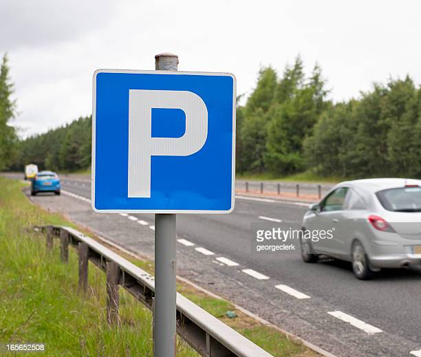 layby break on dual carriageway - parking sign stock photos and pictures