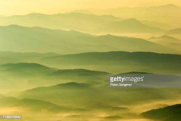 layer of mountains and mist in sunrise time at doi luang chiang dao. - luogo non identificato foto e immagini stock