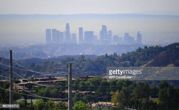 A layer of pollution can be seen hovering over Los Angeles California on October 17 where even though air quality has improved in recent decades smog...