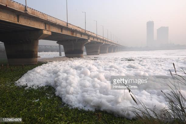 Layer of toxic foam floats on the surface of Yamuna river at Kalindi Kunj, on November 13, 2020 in New Delhi, India. These foams are usually formed...