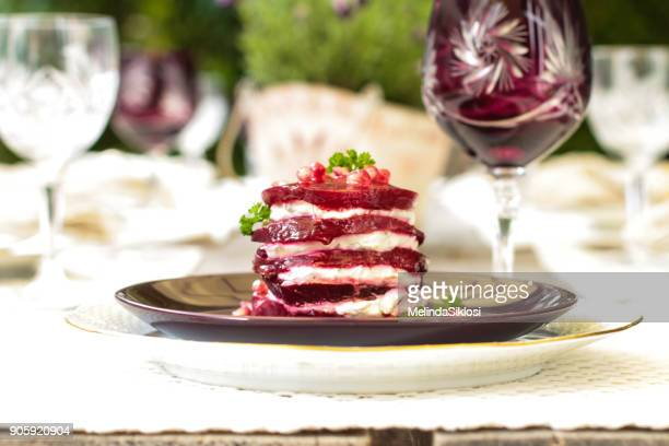 layered beetroot with cream cheese and pomegranate