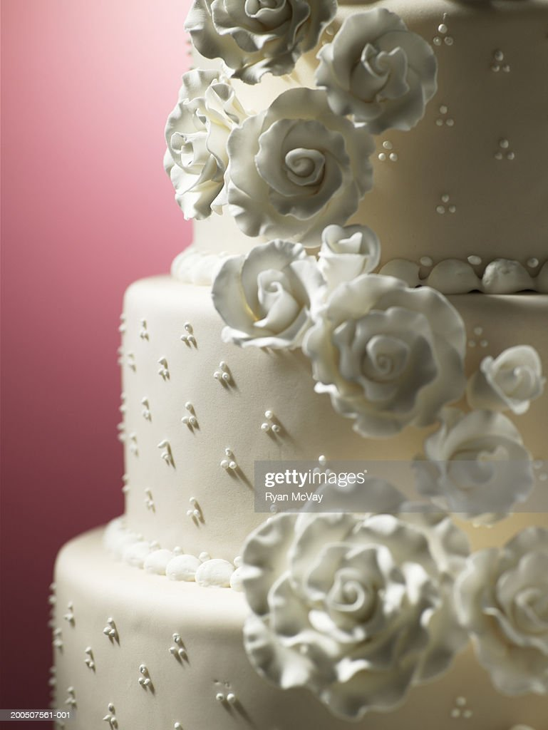 Layered Cake Decorated With Icing Flowers Closeup Stock Photo