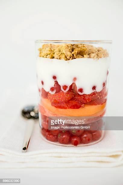 Layered dessert with fresh fruit, yoghurt and muesli