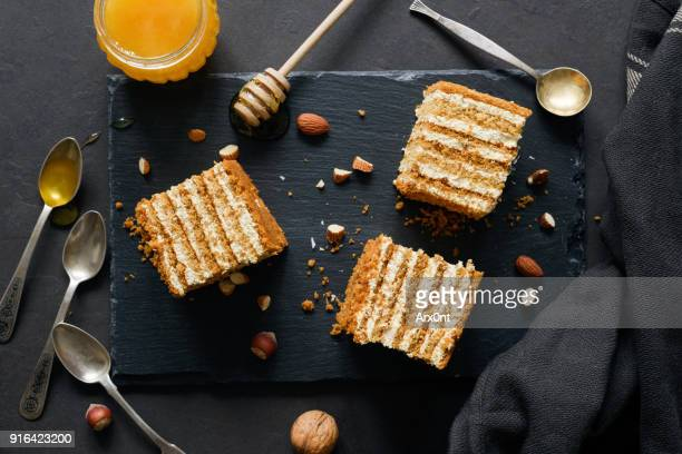 Layered honey cake Medovik on dark background
