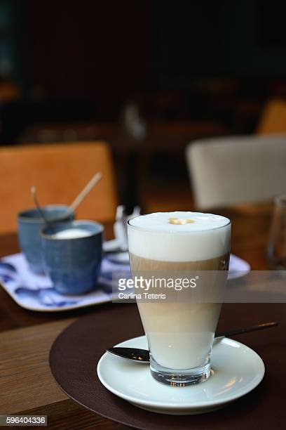 Layered latte in a glass cup in a cafe