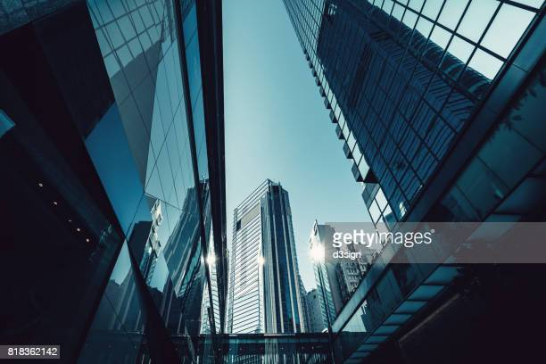 layers of contemporary financial skyscrapers in central business district, hong kong - low angle view stock pictures, royalty-free photos & images